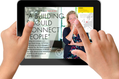 Hands holding ipad showing ECO magazine article