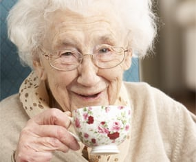Old woman having tea
